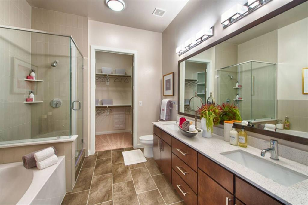 Double vanity with garden tub and stand up shower. BIG walk in Closet