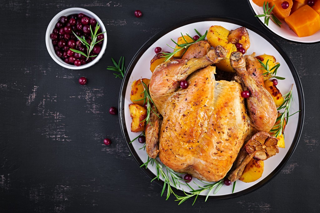 Roasted turkey garnished with cranberries on a rustic style